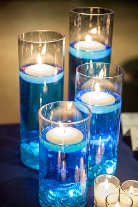 wedding centerpieces with candles and water floating candles blue dyed water tea lights wedding