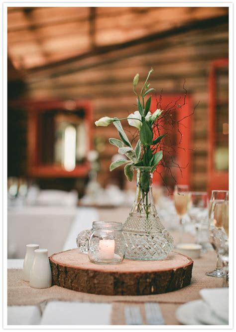 wood centerpiece rustic wood log slice and simple vase centerpiece with flowers photo www