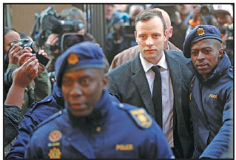 oscar pistorius arrives for his sententencing for the 2013 murder of his reeva