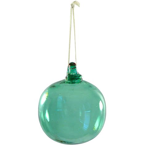 hand blown green glass ball ornament from guatemala fair
