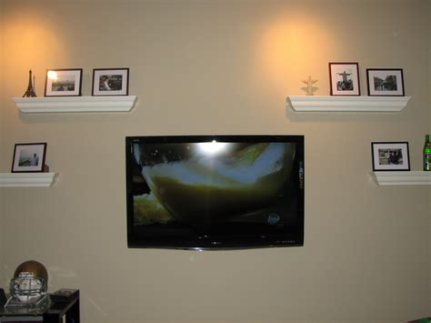 Flat Screen Tv Wall Mount With Shelf by Wall Mounted Flat Screen Tv Surrounded By White Wooden