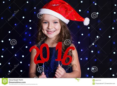 wearing on new year smiling santa with new year date 2016 stock photo