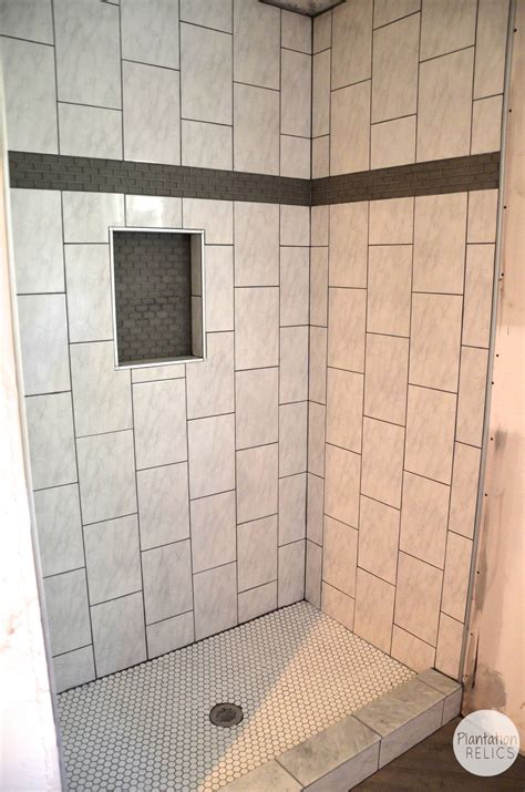 all tile bathroom hall bath tile design it s quite the transformation
