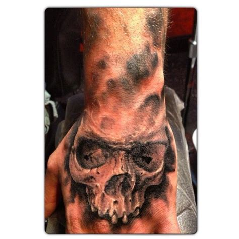 skull tattoo on hand black and grey skull henderson s