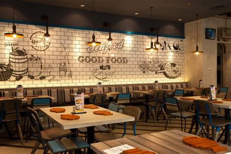 design cafe indonesia fish co restaurant by metaphor interior at puri indah