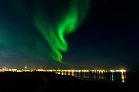 reykjavik iceland northern lights man turns off street lights to see northern lights