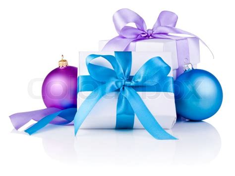purple christmas ribbon two white boxs with a satin ribbon bow purple and blue balls isolated on white