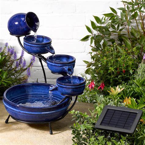 solar powered backyard fountains solar neptune blue cascade water fountain 163 63 36 garden4less uk shop