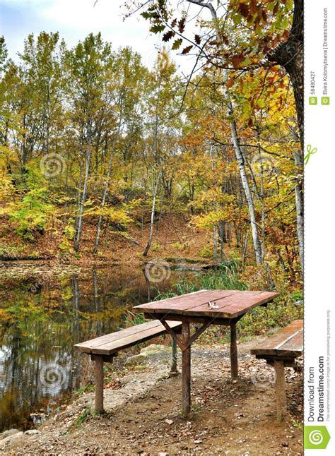 table lake forest picnic on the shore of autumnal forest lake stock photo