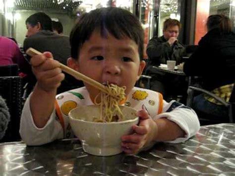 Ramen Eat caden noodle ajisen ramen using chopstick