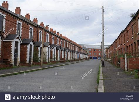 houses to buy in belfast boarded up houses on a street in west belfast stock photo royalty free image