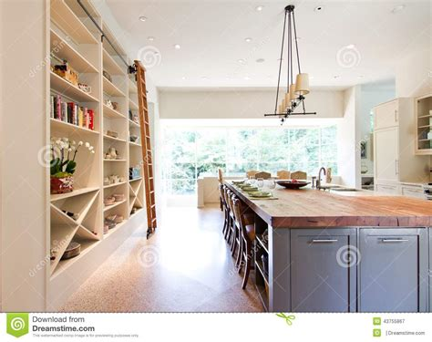 Contemporary White Kitchen Cabinets modern kitchen butcher block top island stock photo