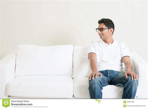 man sitting on couch lonely single asian man sitting on couch and looking at