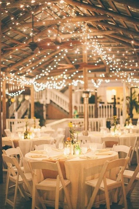 romantic indoor barn wedding decor ideas  lights