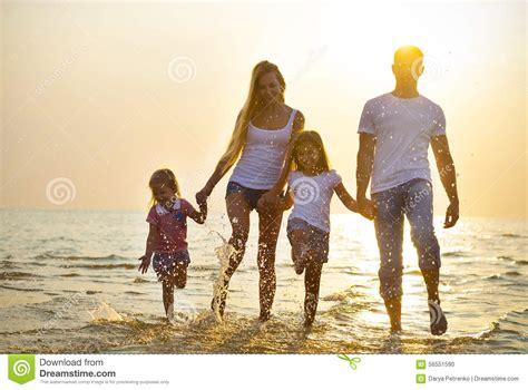 Family Nsun happy family running on at sunset