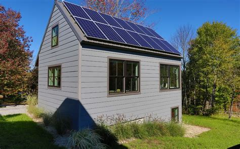 small solar home small cottage house roof top solar panels home