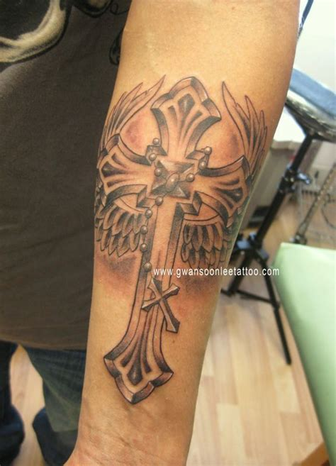 tattoos with crosses and wings cross with wings on arm gwan soon