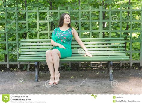 girls bench girl sitting on a bench stock photo image 42756248