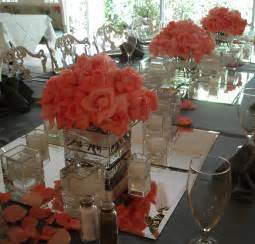 coral wedding centerpieces feasting table with several cube arrangements of marylse