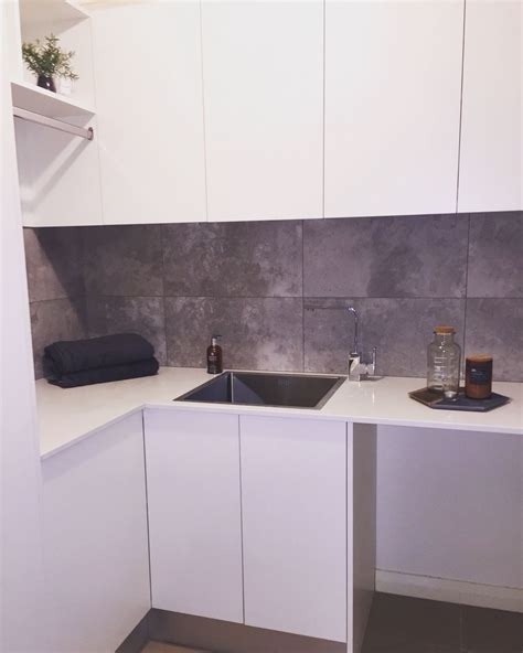 kitchen splashback tiles laundry styling white cupboards white stone benchtops