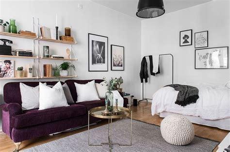 studio apartment with a purple sofa studio loft