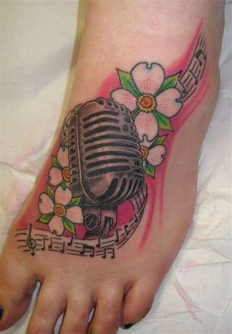 microphone flower tattoo flower and microphone tattoo on left foot