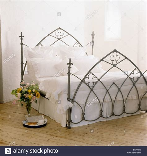 black wrought iron bed gothic style black wrought iron bed with white linen in