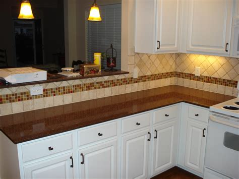 tumbled marble backsplash with multi colored glass accent