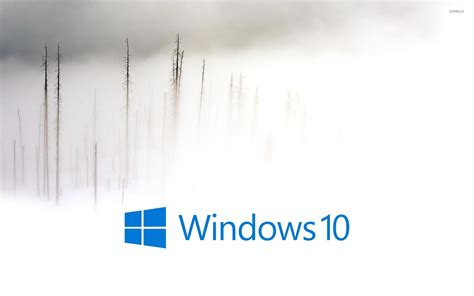 winter wallpaper for windows 10 windows 10 in the foggy winter day blue text logo