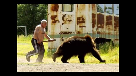 Russian man chases bear with bat