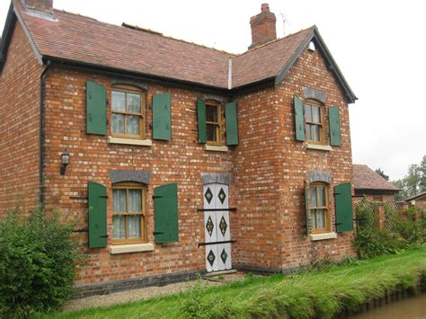 panoramio photo of canalside cottage with iron window