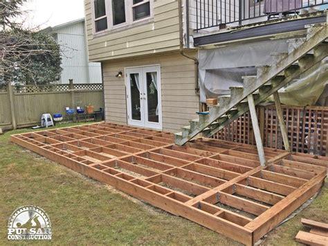 deckscom ground level deck pergola picture