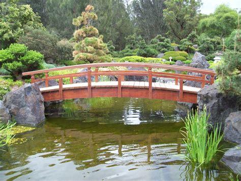 koi pond bridge bridge over the koi pond by melthepirate on deviantart