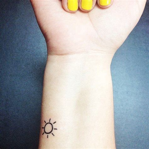 sun tattoo on wrist 20 simple tattoos for pretty designs