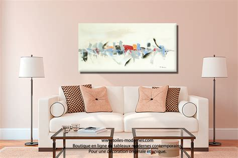 Ordinaire Decoration Salle A Manger Peinture #2: Tableau-au-dessus-canap%C3%A9-cr%C3%A8me-ivoire-moderne-Reflets-sur-l--Beau.jpg