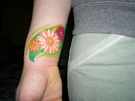 daisy tattoo on wrist tattoos
