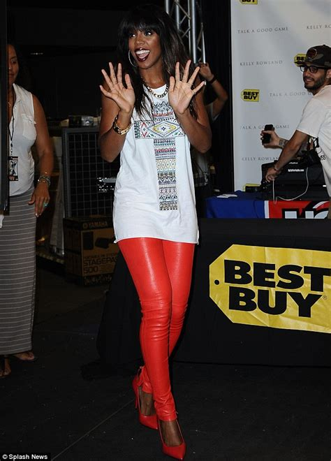 kelly rowland in a white tank top highlighing derriere in kelly rowland dons scarlet skintight leather trousers to