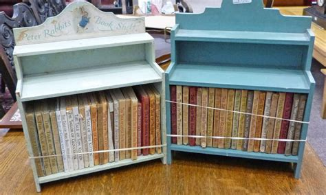 43 volumes by beatrix potter various dates in 2 wooden