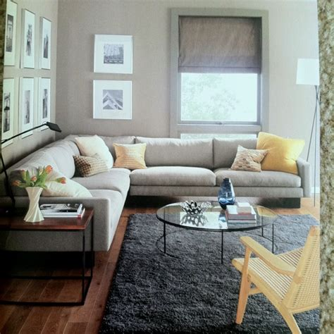 yellow sofa dark pillows dark rug grey cabinet and black grey couch yellow pillows black white photography