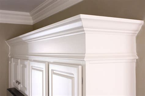 crown molding for kitchen cabinet tops the yellow cape cod cabinets taller builder