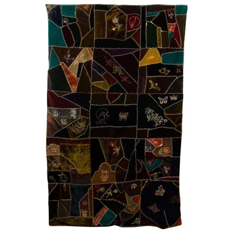 Antique Handmade Quilts Value - an antique handmade quilt in embroidered velvet at