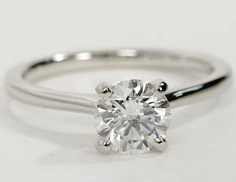 thin solitaire engagement ring in platinum