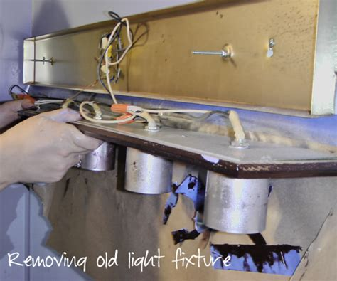 how to remove rust from bathroom light fixture how to remove bathroom light fixture changing out a