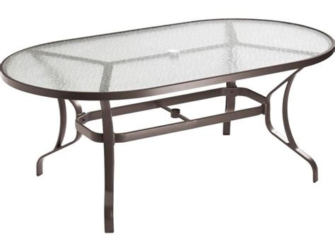 Oval Cast Aluminum Patio Table Tropitone Cast Aluminum 72 X 40 Oval Dining Table With Umbrella 500072gu