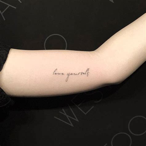 love yourself tattoo yourself on the left inner arm