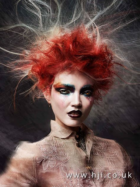 messy redhead avant garde updo hairstyle  stray