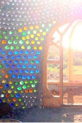 Through The Healing Glass bottle wall earthship and bottle on