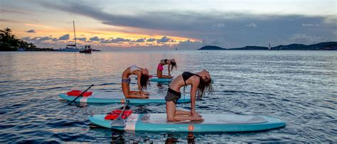 paddle boat yoga sup yoga vi stand up paddle board yoga classes in st