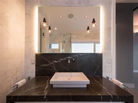 soapstone bathtub bathroom with gray paisley wallpaper transitional bathroom