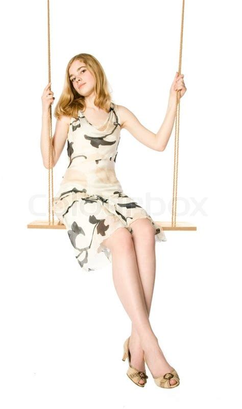 www swing life style com young blonde sitting on a swing white background stock